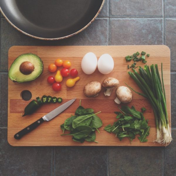 Cutting board with a knife and assorted vegetables