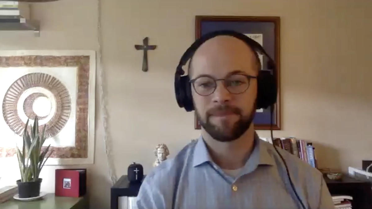 Music Ministry Director Brandon Heishman shown from the shoulders up as he leads a hymn via Zoom.