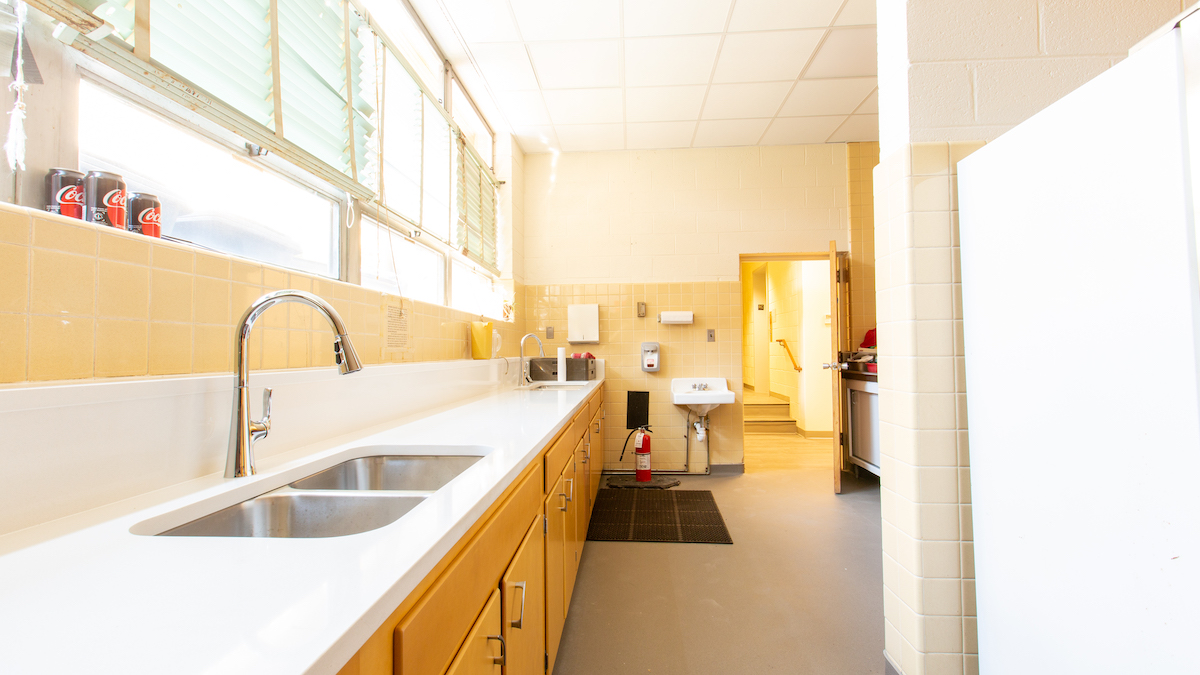Newly upgraded kitchen sink, counter and cabinets, lower level of church